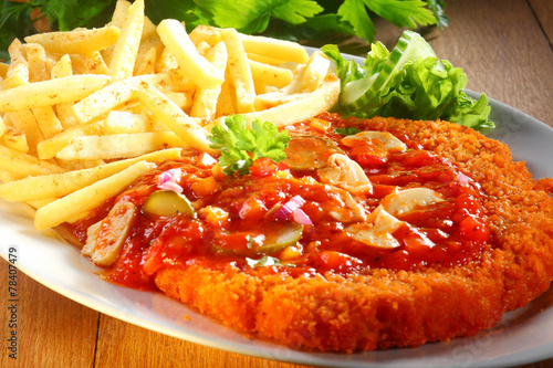 Tasty Crumbled Zigeunerschnitzel Paired with Fries - 78407479