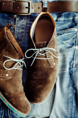 Detail of denim jeans and leather shoes