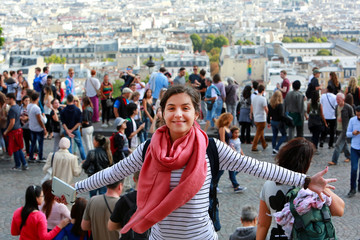 Happy beautiful girl on Montmartre in Paris