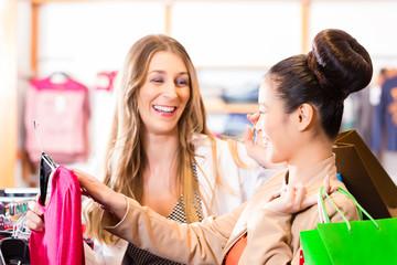 Women buying fashion in shop or store