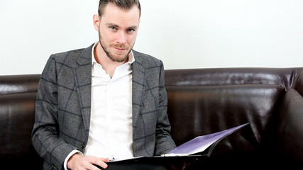 Businessman closeup with clipboard
