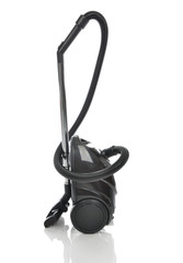 Powerfull black Vacuum cleaner on the floor