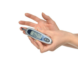 Diabetes patient hands measuring glucose level blood test