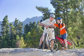Grandfather and Grandson on mountain bikes