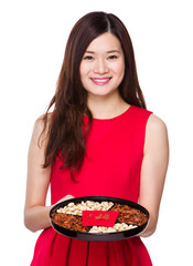 Asian woman hold with snack tray