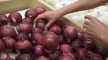 Woman Shopping for Red Onions Handheld