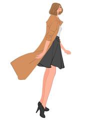 ロングコートを着たショートカットの女性