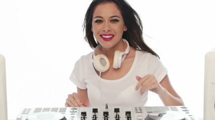 Young Female Mixing Music Using DJ Mixer