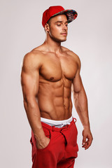 Muscular man in red cap.