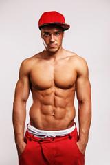 Muscular man in red cap.
