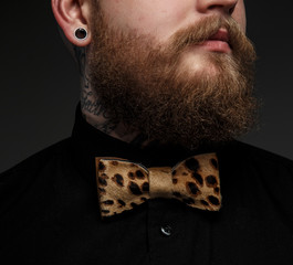 Man in black shirt and bow tie.