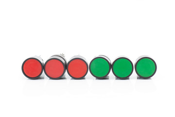 Red and Green push button switch on isolated background