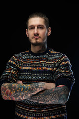 Portrait of a man with tattooes.