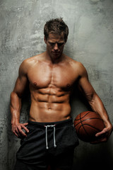 Muscular female with basket ball.