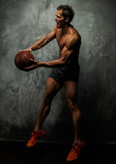 Muscular female with basket ball