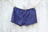 blue boxer underwear on grunge wall