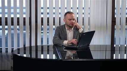 Businessman typing and showing on screen female contributor