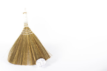 isolated besom and white waste paper