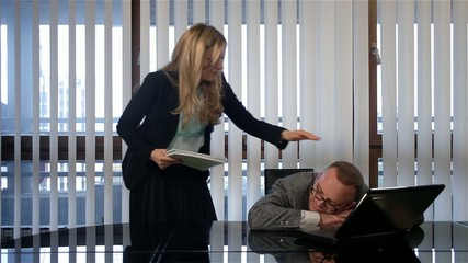 Pretty woman gently wakes up colleague at work,funny scene