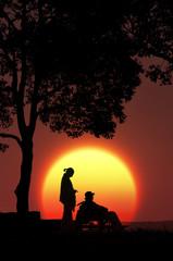 夕日と車椅子