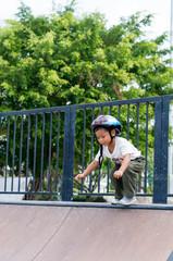 Happy child wearing a bike helmet outdoors