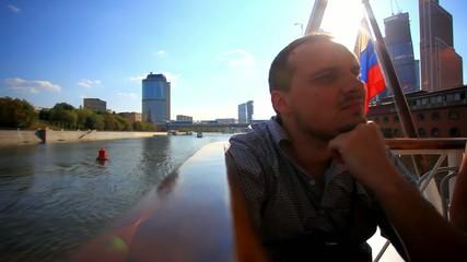 young pensive man enjoying cruise. HD. 1920x1080