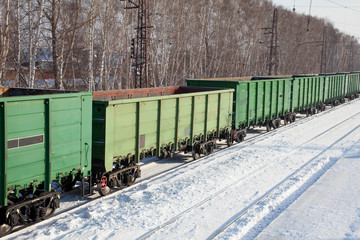 freight cars at the station in winter