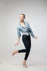 Smiling student girl with one leg up