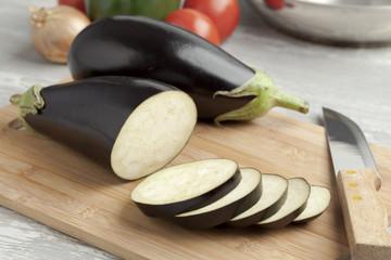 Fresh purple eggplants and slices