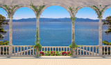 Terrace with balustrade overlooking the sea and mountains