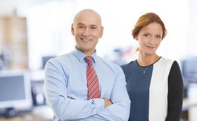 Business woman and businessman portrait