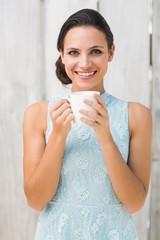 Stylish brunette holding a mug