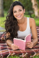 Pretty brunette reading a book