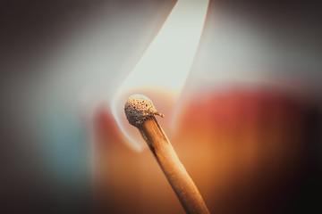 Single burning matc on warm background