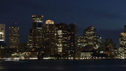 Time lapse close up pan shot slow Boston skyline at twilight