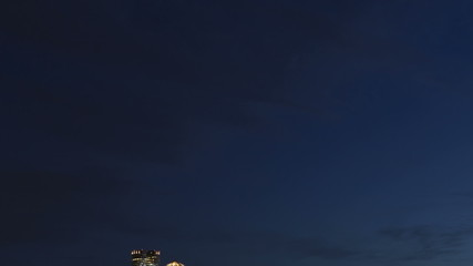 Time lapse close up tilt shot up Boston skyline at twilight