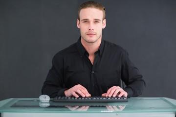 Focused businessman typing on keyboard