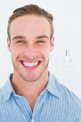 Happy handsome in shirt in front of eye test
