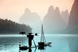 Chinese man fishing with cormorants birds - 78424682