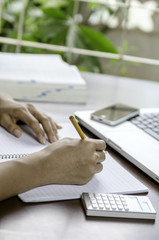 Image of woman taking note