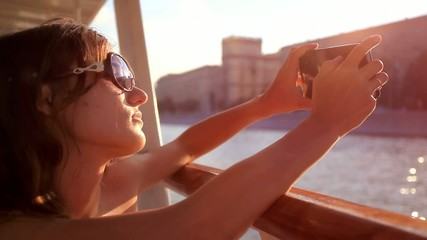 Young beautiful woman with sunglasses taking picture With