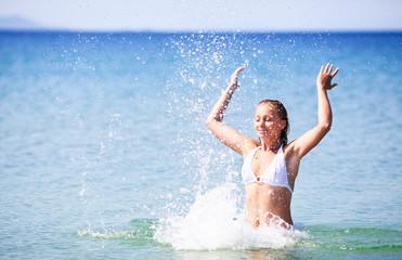 Woman Enjoying In The Sea