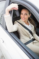 Businesswoman smiling and holding key