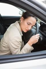 Businesswoman sleeping on the wheel