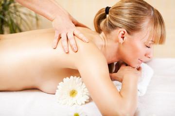 Woman Receiving Back Massage