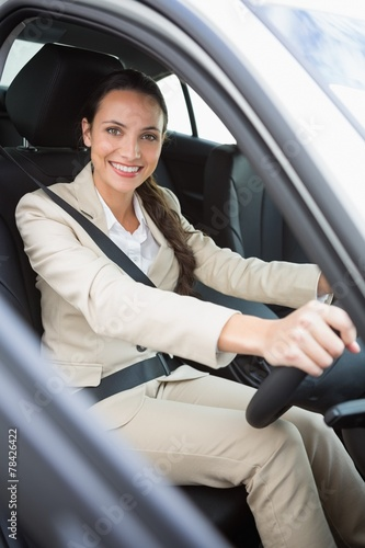 canvas print picture Pretty businesswoman smiling and driving