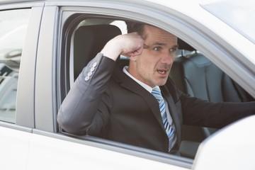 Businessman experiencing road rage