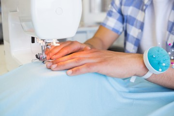 College student using sewing machine