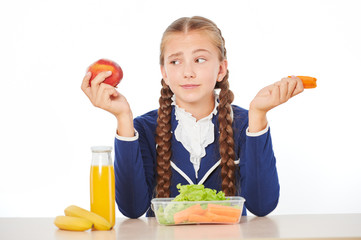 Girl disappointed by her healthy lunch at school