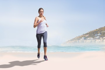 Composite image of focused fit blonde jogging